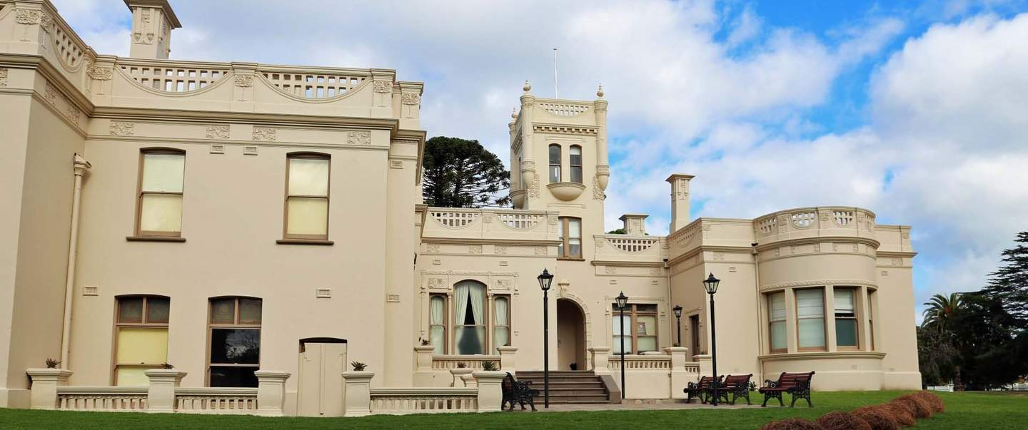 Exterior view of a cream coloured mansion