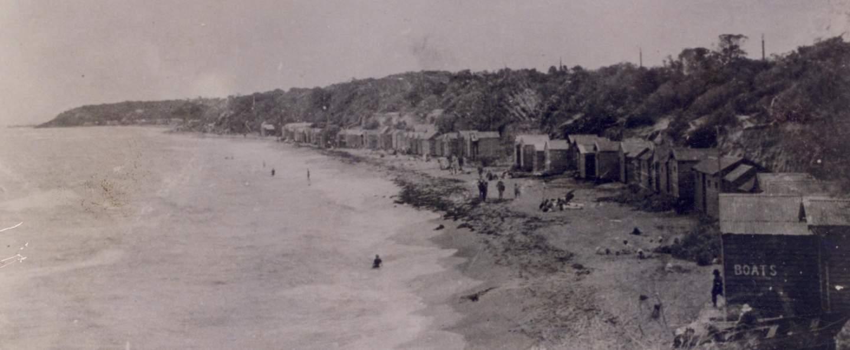 Old black and white photo of Brighton Bathing boxes