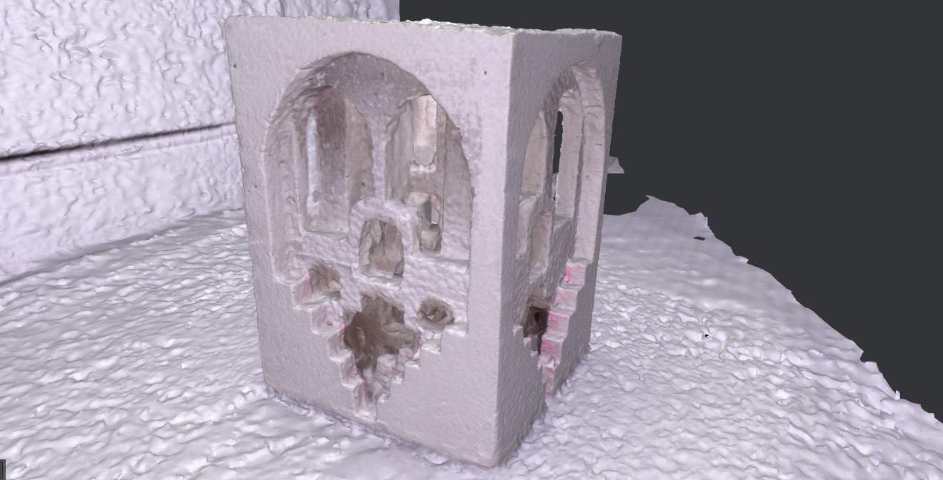 Black and white digitised image of a foam cube with carved stairwells and archways.